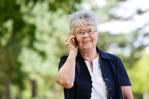 Portrait of smiling senior woman having conversation on mobile phone